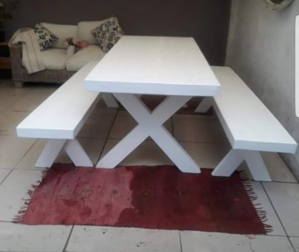 white crossed leg dining table and beches